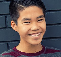 Preteen boy with braces