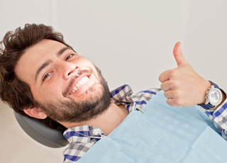 dental patient giving thumbs up