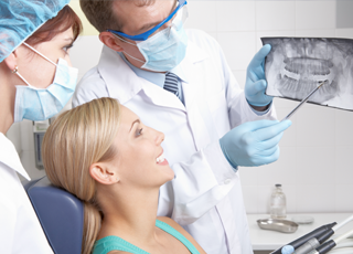 woman looking at xrays with dentist