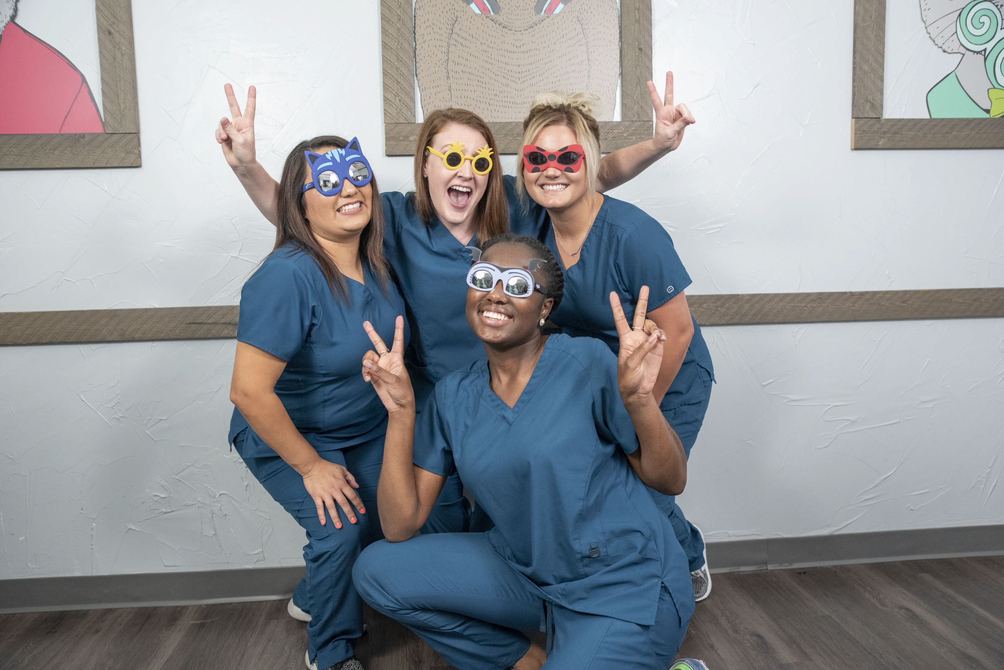 Dental team with funny props