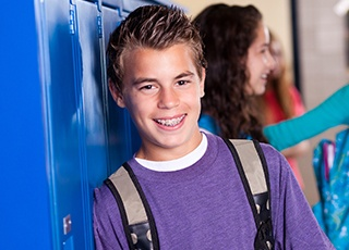 Teen boy at school with braces